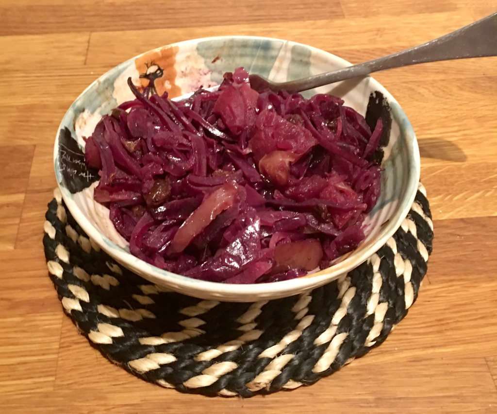a bowl on a coaster. Bowl contains cabbage apple dish described in the post.